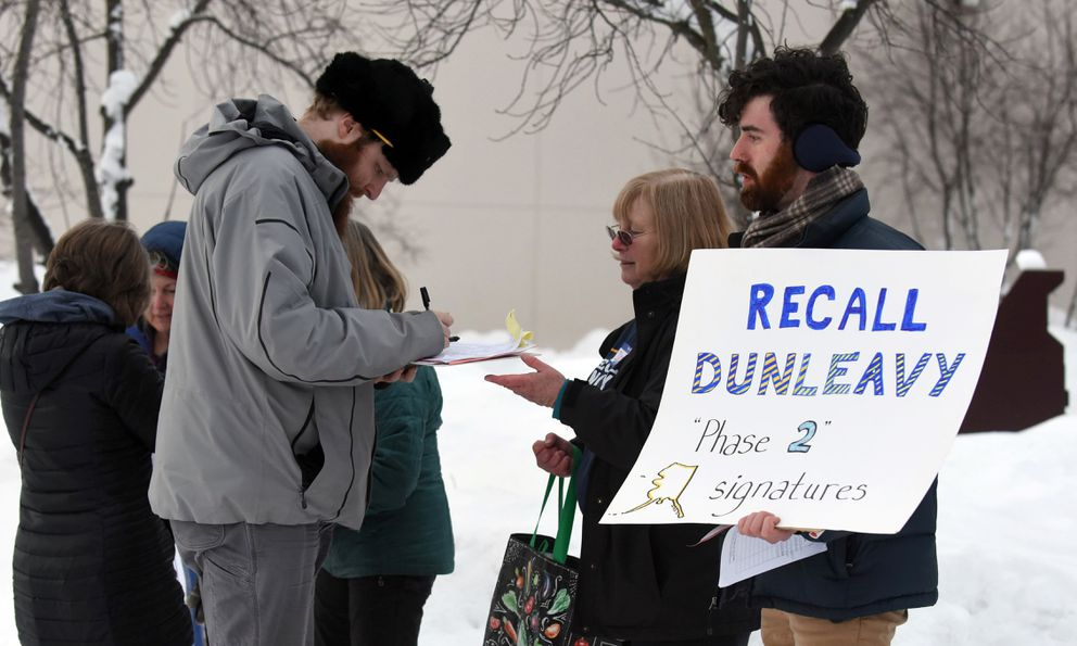 Recall Dunleavy campaign volunteers gather signatures before a town hall meeting at the Steve Primis Auditorium at Chugiak High School on Monday, March 2, 2020 in Chugiak, Alaska. (Matt Tunseth / ADN)