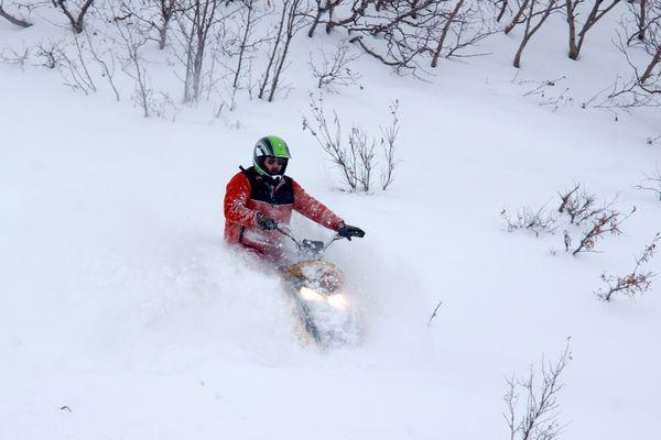 A rider snowmachines near Paxson after the 2006 Arctic Man Ski and Sno-Go Classic. (Bob Hallinen / ADN)
