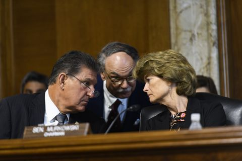 Sen. Lisa Murkowski, chair of the Senate Energy and Natural Resources Committee, right, talks with ranking member Sen. Joe Manchin, D-West Virginia, left, and counselor Sam Fowler on June 18, 2019. (Marc Lester / ADN)