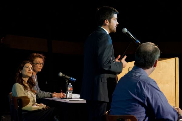 Taylor Bickford states his case at the podium during the UAA Seawolf Debate Team and Alaska Dispatch News debate on Thursday, October 23, 2014, about marijuana legalization in Alaska.