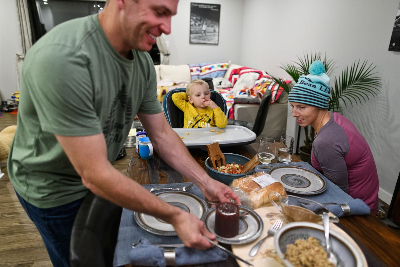 On Thanksgiving Day in Canada, Jeff Ellis places dinner on the family's dining room table on Oct. 8. (Marc Lester / ADN)