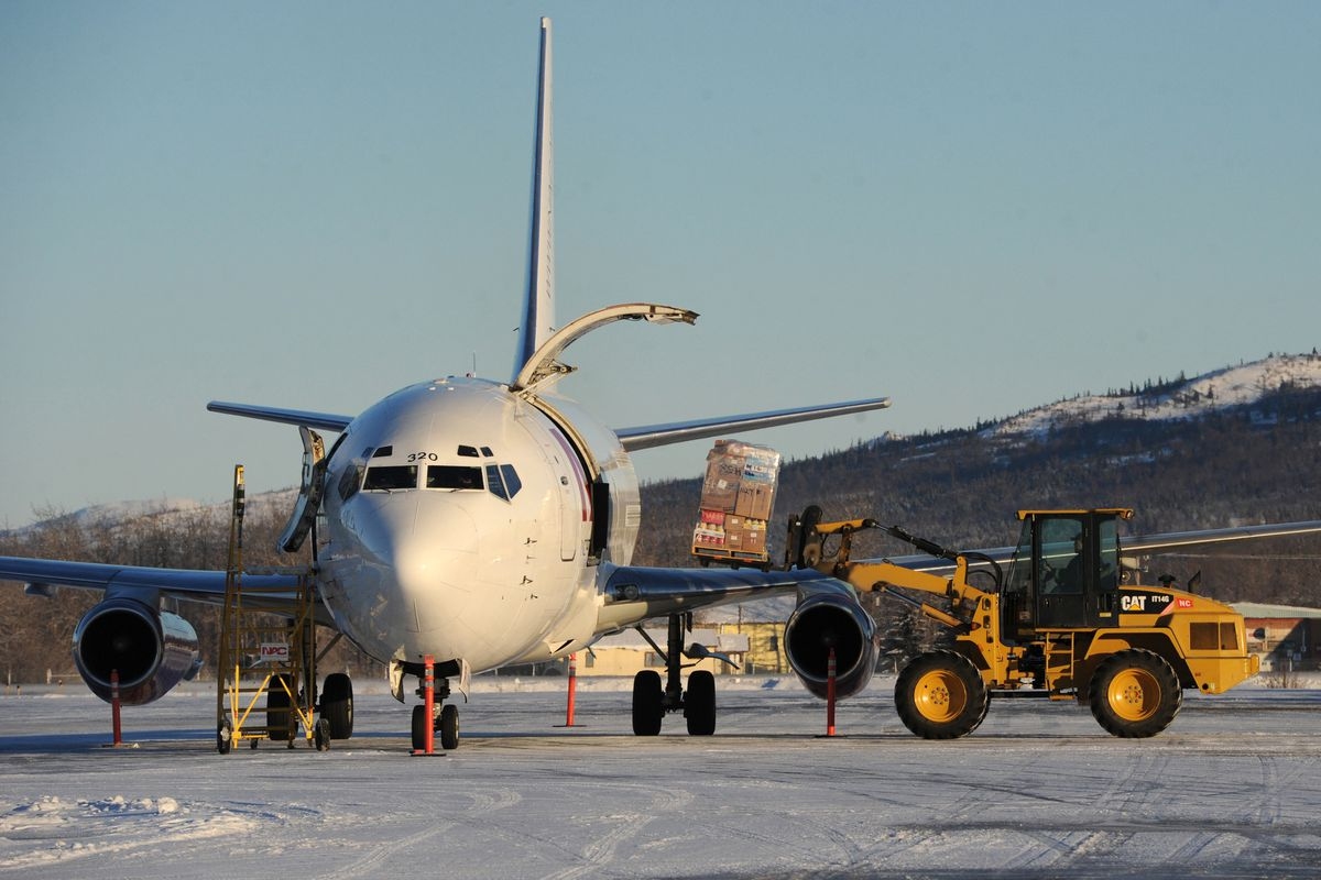 Freight is off-loaded from a Northern Air Cargo Boeing 737-200 at the Aniak Airport on Tuesday, Jan. 10, 2017. (Bill Roth / Alaska Dispatch News)