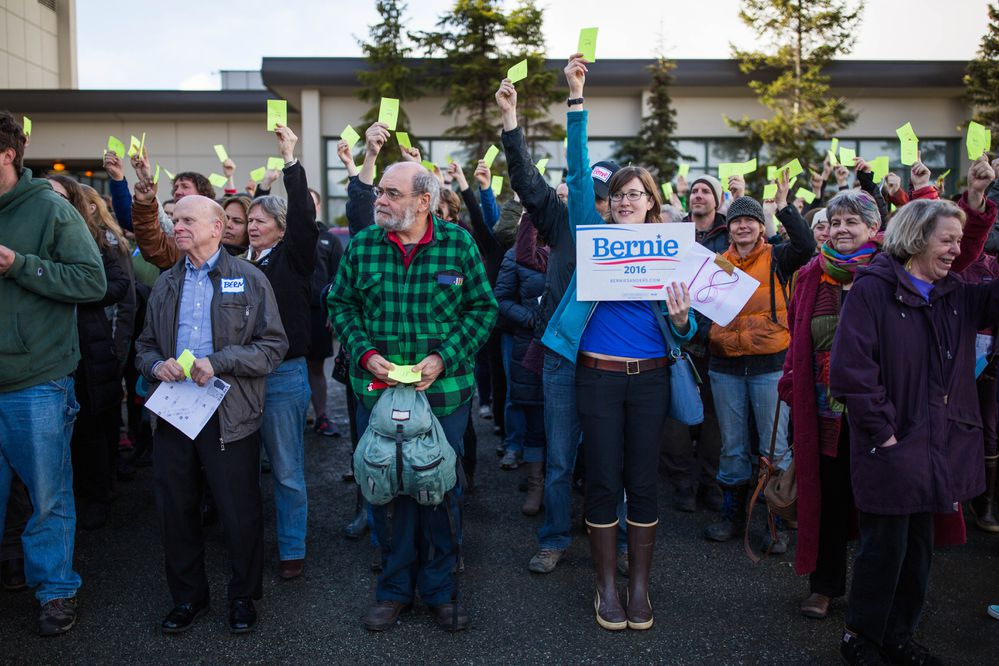 Alaska democrats, including sign holder Danielle Best, caucus for Bernie Sanders in the parking lot of West High School on Saturday, Mar. 26, 2016. The Anchorage Fire Department estimated the crowd at over 5,000, double the number of democrats that caucused in Anchorage in 2008. (Loren Holmes / ADN)