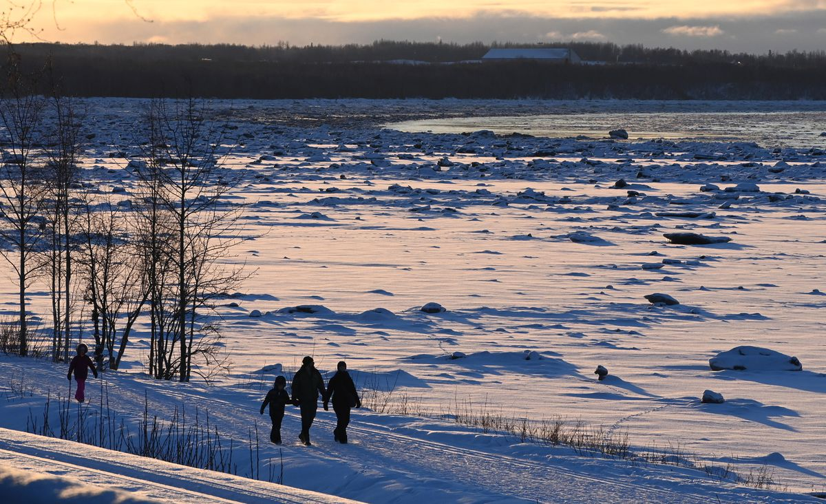 People walk along the Tony Knowles Coastal Trail during sunset on Feb. 4. (Bill Roth / ADN)