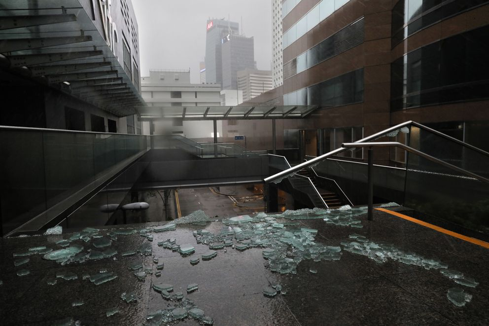 Broken glass from windows caused by Typhoon Mangkhut is seen on a pedestrian pathway in Hong Kong, Sunday, Sept. 16, 2018. Hong Kong and southern China hunkered down as strong winds and heavy rain from Typhoon Mangkhut lash the densely populated coast. The biggest storm of the year left at least 28 dead from landslides and drownings as it sliced through the northern Philippines. (AP Photo/Vincent Yu)