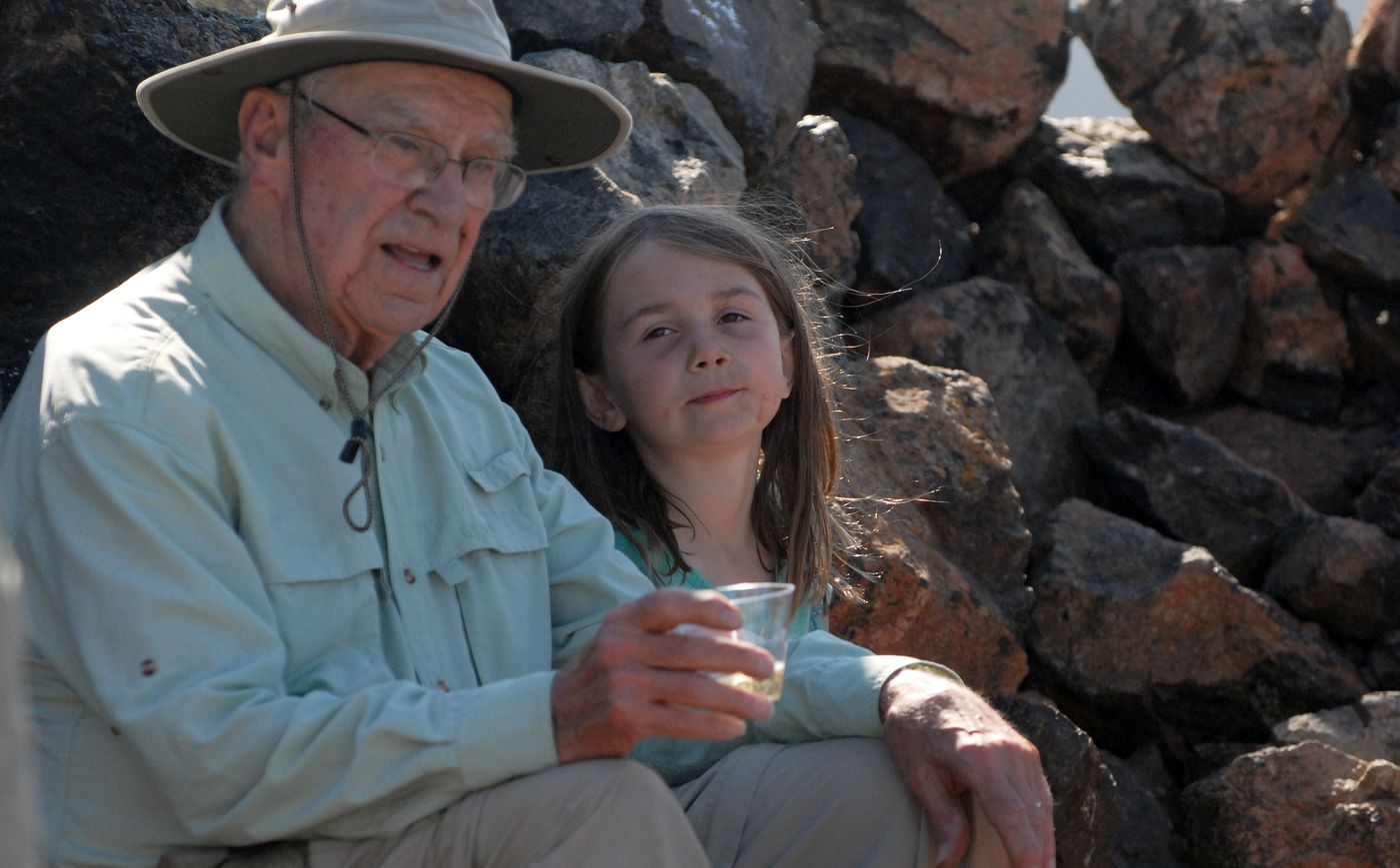 Kierstin Clark sits next to her great-grandfather, George Wooliver, after climbing to the top of Flattop Mountain in Chugach State Park on Friday, July 5, 2019. (CORRECTION: A previous version of this caption said Clark is Wooliver's granddaughter). (Matt Tunseth / ADN)