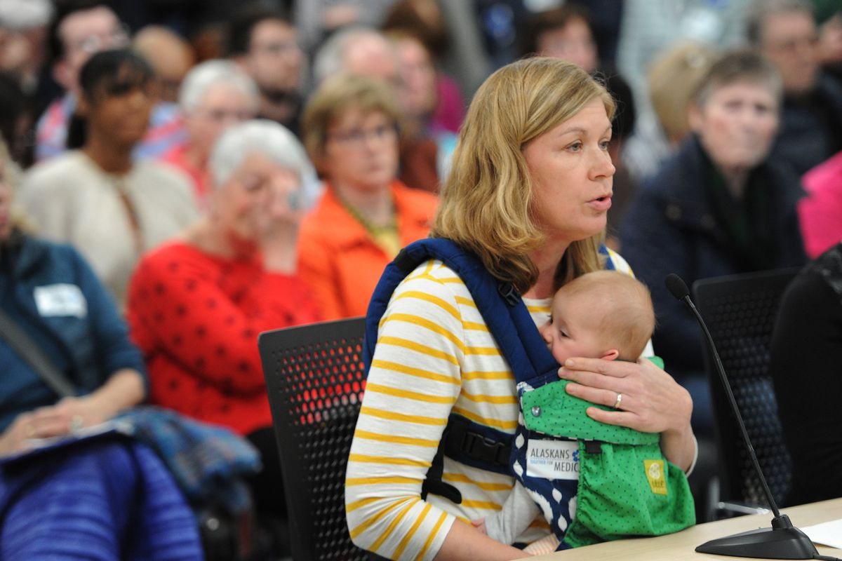 Sara Dykstra holds her 4 1/2 month-old son Ari Cohn as she testified during the State House budget input hearing in the Anchorage LIO on Sunday, March 24, 2019. (Bill Roth / ADN)