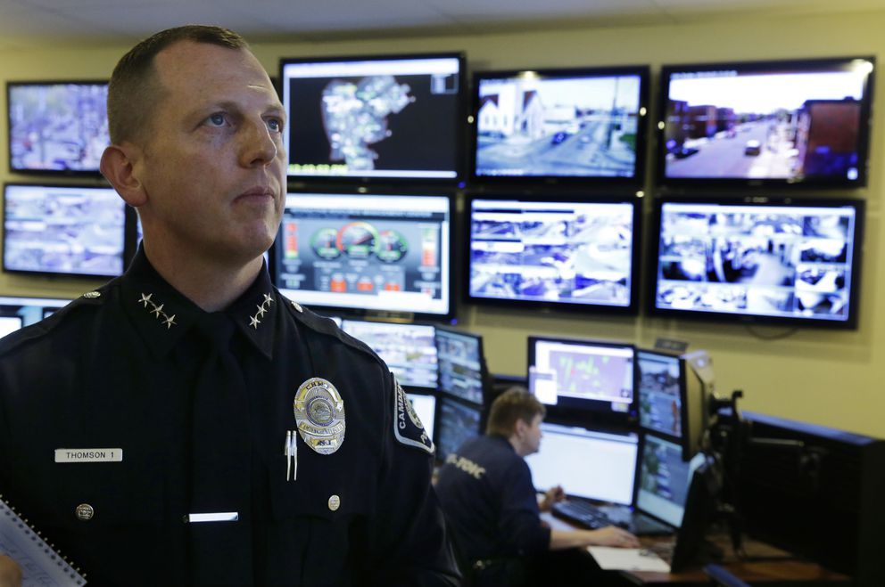 FILE - In this April 22, 2014, file photo, then Chief Scott Thomson watches one of the live video monitors in the command center of the Camden County Metro police in Camden, N.J. (AP Photo/Mel Evans, File)