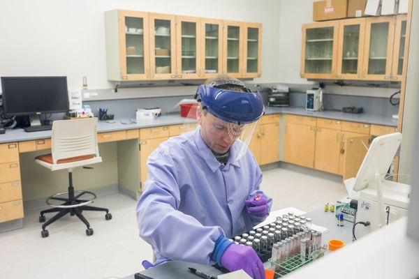 Forensic scientist Charles Foster works in the blood alcohol analysis room at the State of Alaska's Scientific Crime Detection Laboratory on Wednesday, Jan. 18, 2017. (Loren Holmes / Alaska Dispatch News)