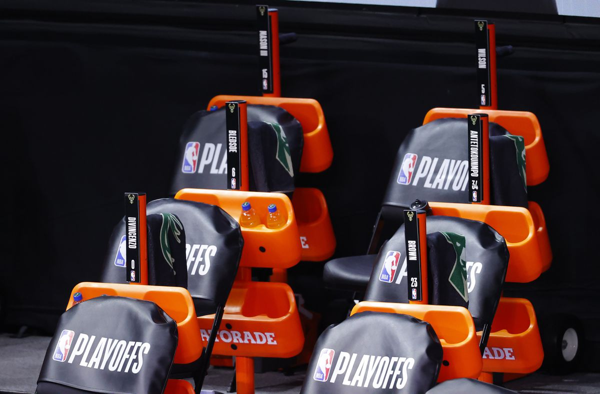 The Milwaukee Bucks bench sits empty at game time of a scheduled game between the Milwaukee Bucks and the Orlando Magic for Game 5 of an NBA basketball first-round playoff series, Wednesday, Aug. 26, 2020, in Lake Buena Vista, Fla. (Kevin C. Cox/Pool Photo via AP)