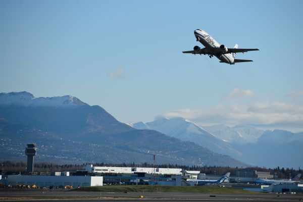Alaska Airlines flight 66, the last flight of the 737-400 Combi aircraft in its fleet, takes off from Ted Stevens Anchorage International Airport. The final flight of an Alaska Airlines Boeing 737-400 Combi aircraft departed Anchorage on Oct. 18, 2017. Alaska Airlines operated five of the jets, which were configured carry freight in the front and passengers in the rear. The company is transitioning to dedicated cargo aircraft in Alaska. (Marc Lester / Alaska Dispatch News)