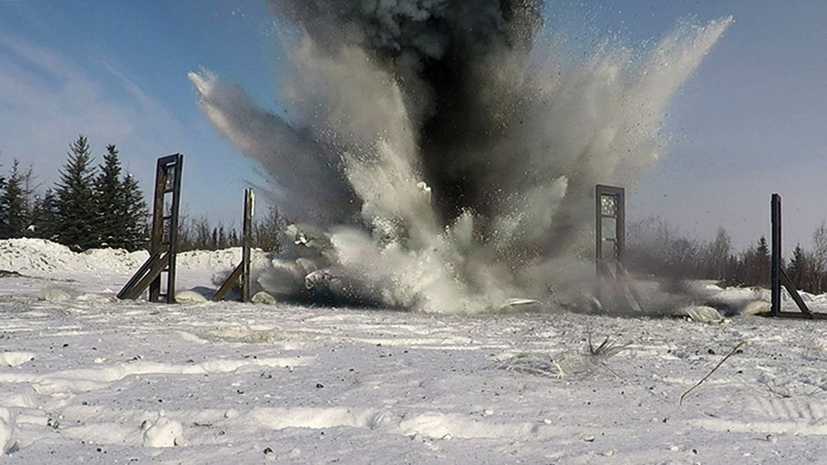 U.S. Air Force airmen from the 354th Civil Engineer Squadron Explosive Ordnance Disposal (EOD) flight, the Iceman Spark Innovation team, Air Force Research Laboratory's innovation team and other partners set off an explosion from afar for the EOD snow mitigation test March 18, 2021 at Eielson Air Force Base near Fairbanks. The experiment tested the use of snow to mitigate the damaging effects of explosions in an arctic environment. (U.S. photo by Senior Airman Danielle Sukhlall)