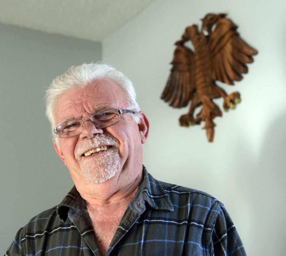 Medzit Lena spoke about driving and owning permits on  March 22 at his South Anchorage home. The two-headed eagle, a symbol of his native Albania, was carved by a family member back in his village. (Erik Hill / Alaska Dispatch News)