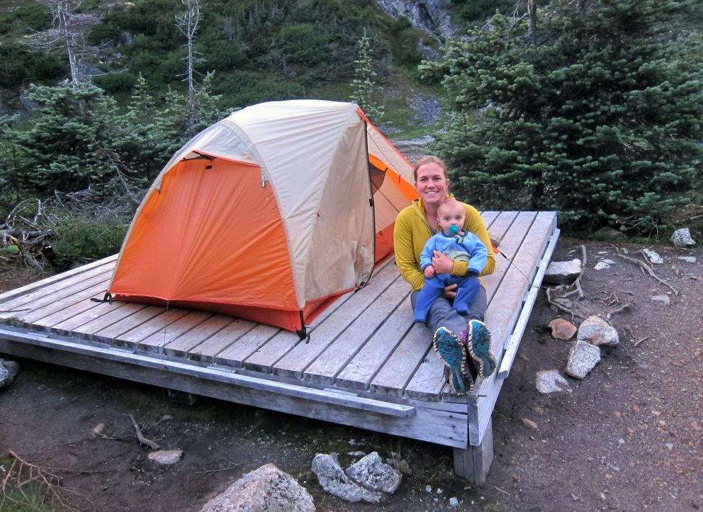 Heather Helzer and Finch take play time at a campsite along the trail. Helzer made a point of establishing a hike-rest-hike routine for her three-night, four-day journey. (Courtesy Heather Helzer)