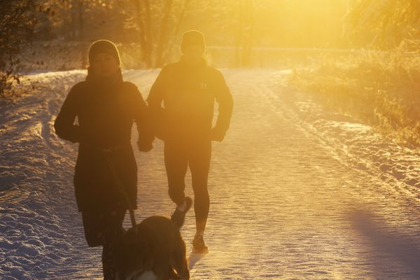 People run along the Tony Knowles Coastal Trail in Anchorage as temperatures hovered in the teens on Nov. 17, 2020. (Emily Mesner / ADN)