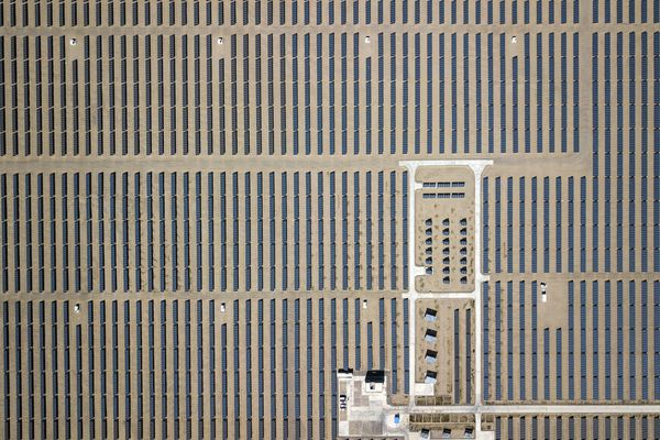 Photovoltaic panels stand at a solar power station operated by Huanghe Hydropower Development Co., a unit of State Power Investment Corp., at the Golmud Solar Park in this aerial photograph taken on the outskirts of Golmud, Qinghai province, China, on July 24, 2018. MUST CREDIT: Qilai Shen/Bloomberg