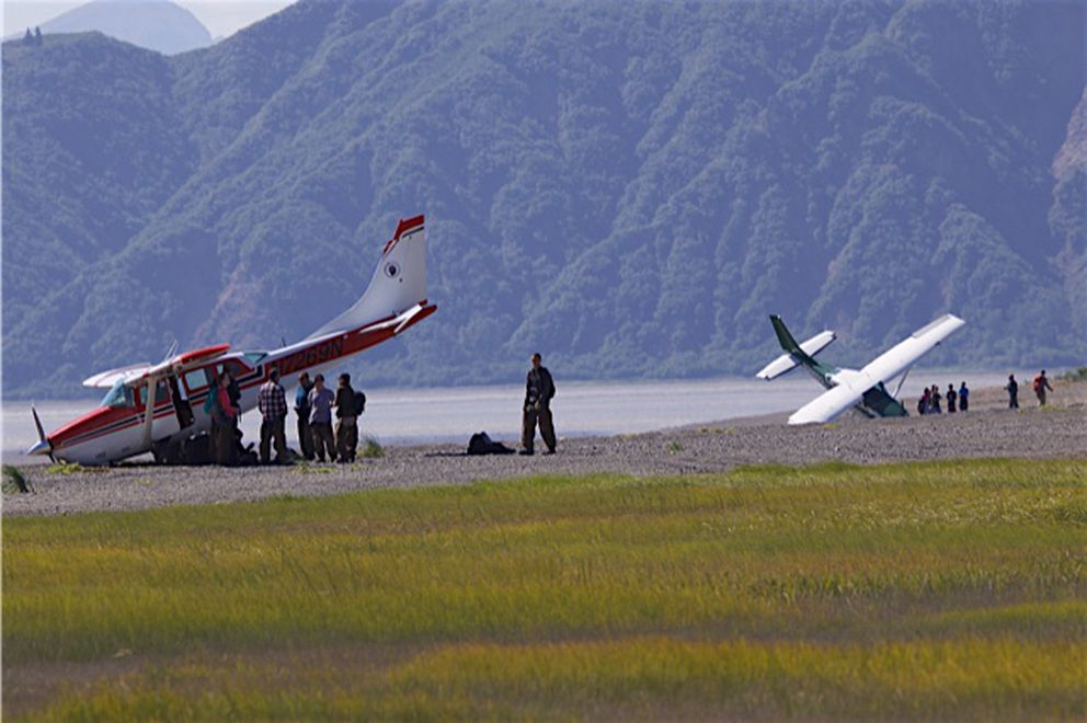 Planes flown by two air tour operators nosed over on a beach on Chinitna Bay in 2016. No injuries were reported among the six people on board. (Courtesy Richard Hojohn)