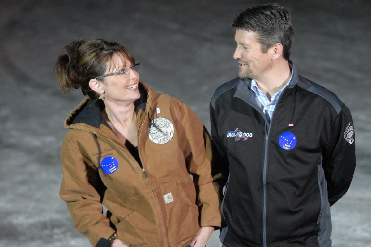 Republican Vice Presidential candidate Alaska Governor Sarah Palin and her husband Todd Palin talk to the media after voting in Wasilla in 2008. (Bill Roth / ADN)