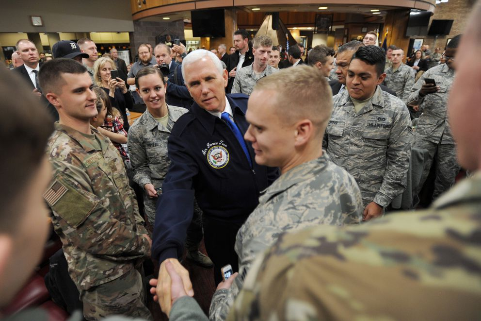 Vice President Mike Pence has his picture taken with Airman First Class Christopher Larry-Lewis and Airman First Class Prastashia Bowden while visiting with troops at the Iditarod Dining Facility on Joint Base Elmendorf-Richardson on Veterans Day on Sunday, Nov. 11, 2018, while on a refueling stop on his way to Tokyo. (Bill Roth / ADN)