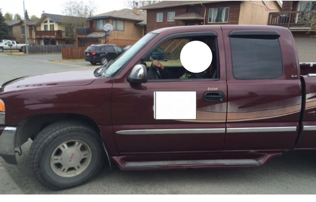 The truck that was stolen and involved in Monday's shooting at Value Village in East Anchorage. The driver's face and a former business magnet were blocked out at the request of the registered owner. (Photo via APD)