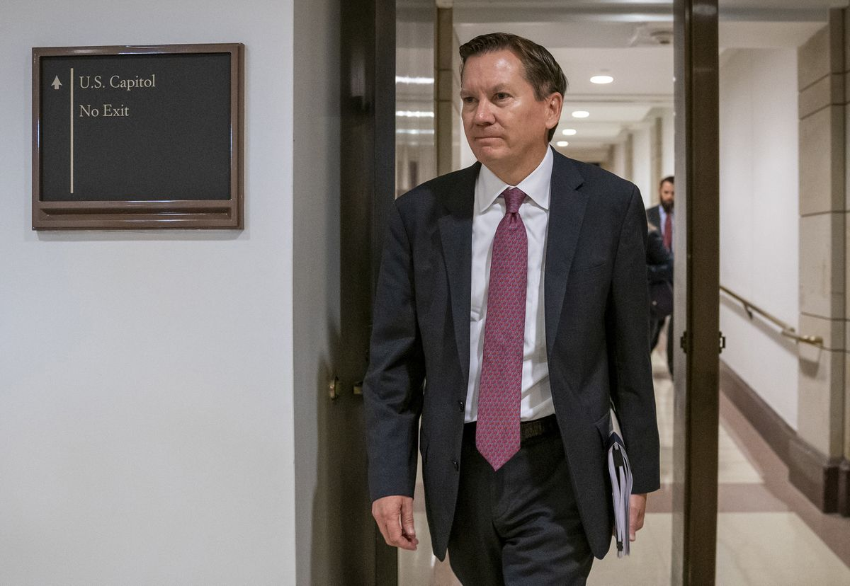 FILE - In this Oct. 4, 2019, file photo, Michael Atkinson, the inspector general of the intelligence community, arrives at the Capitol in Washington for closed-door questioning about a whistleblower complaint that triggered President Donald Trump's impeachment. (AP Photo/J. Scott Applewhite, File)