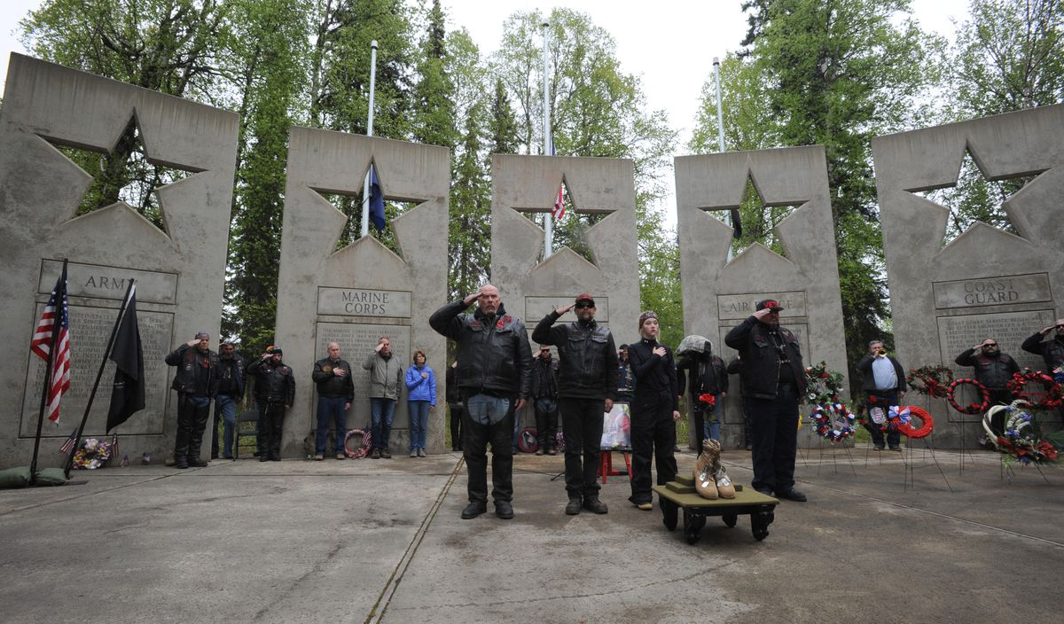 """Veterans salute while performing a Fallen Warrior Memorial during the the Rolling Thunder Memorial Day ceremony at the Alaska Veterans Memorial at Byers Lake in the Alaska State Parks on Sunday, May 28, 2017. Sec. Ryan told the crowd that """"our nation has alway sacrificed our greatest treasure which is our young."""" (Bill Roth / Alaska Dispatch News)"""
