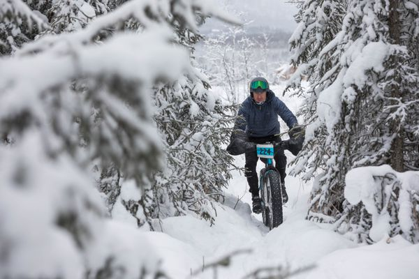 Ron Kuzina navigates a single-track section of trail during the Merry Masher fat-tire bike race on Saturday, Dec. 29, 2018. (Loren Holmes / ADN)