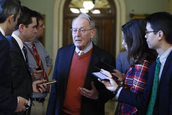 Sen. Lamar Alexander, R-Tenn., talks to reporters as he walks past the Senate chamber prior to the start of the impeachment trial of President Donald Trump at the U.S. Capitol Friday Jan 31, 2020, in Washington. Senators continue the impeachment trial for President Donald Trump. (AP Photo/Steve Helber)