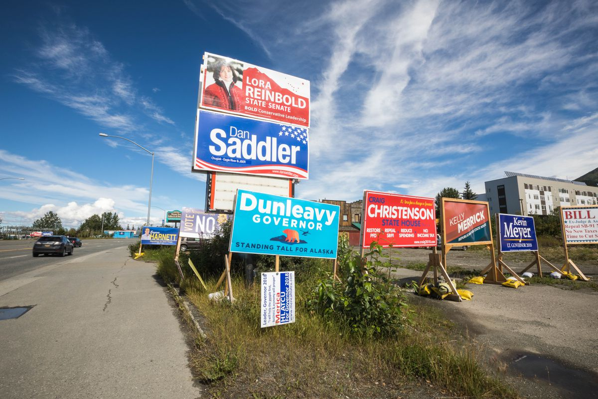 Political signs line the Old Glenn Highway in Eagle River on Friday, Aug. 3. (Loren Holmes / ADN)