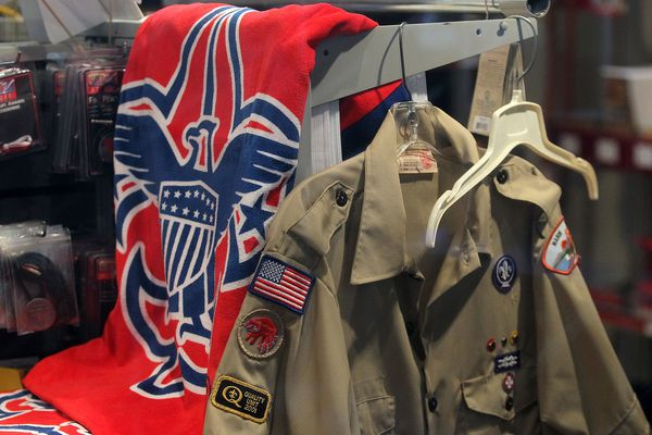 The Boy Scout logo and a uniform are displayed in a store at the Marin Council of the Boy Scouts of America on July 27, 2015 in San Rafael, Calif. There are more than 12,200 reported victims of sexual abuse in the youth organization over the years. (Justin Sullivan/Getty Images/TNS)