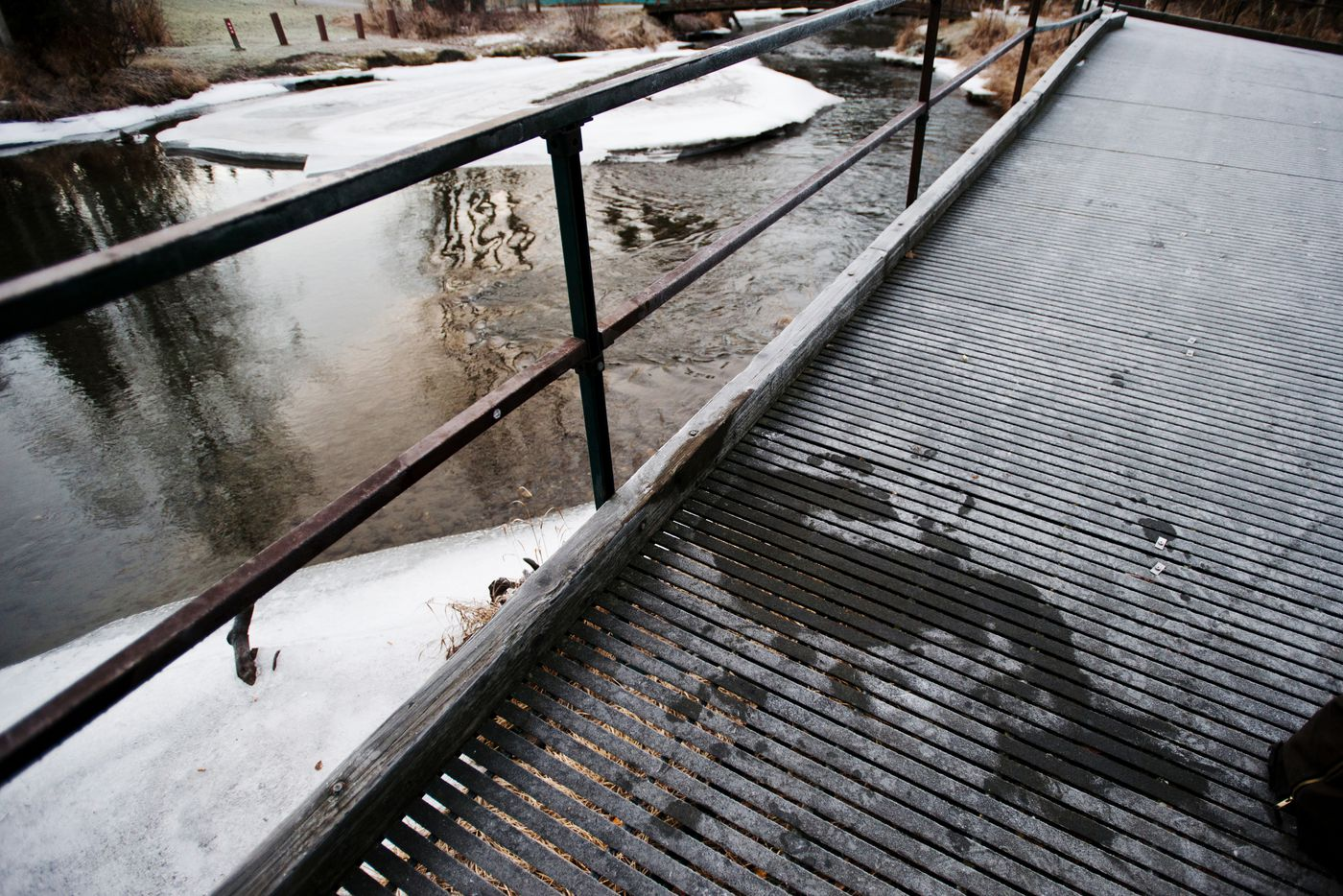 A melted area of frost on the decking of a viewing platform at Campbell Park shows where a man was sleeping. The Deck, as it is known, is a popular drinking spot for homeless people in the area. Photographed on Tuesday, December 9, 2014. Marc Lester / ADN