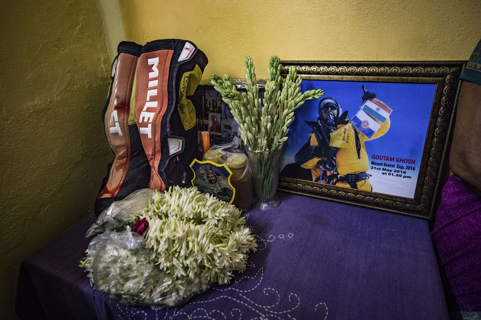 A tribute to Goutam Ghosh, with the last photograph taken of him at the South Summit on Everest, in his house, including his climbing boots, in Kolkata, India, June 2, 2017. Sherpas took on a quest to find the bodies of climbers Ghosh and Paresh Nath — a year after they were abandoned near the top of Mount Everest — and bring them home. (Josh Haner/The New York Times)