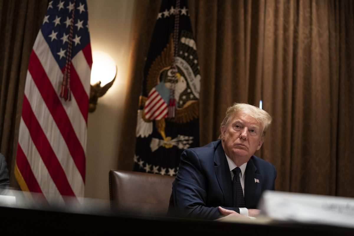 President Donald Trump listens during a meeting on opportunity zones in the Cabinet Room of the White House, Monday, May 18, 2020, in Washington. (AP Photo/Evan Vucci)