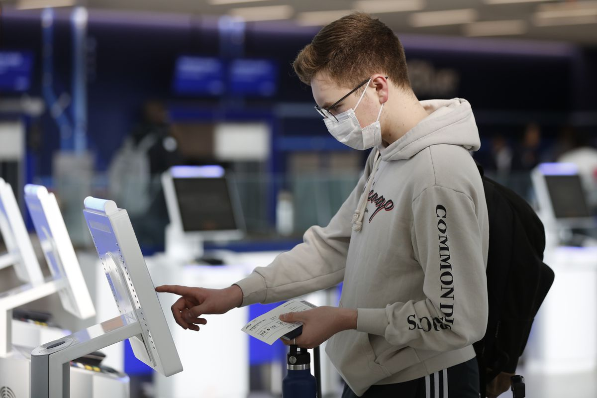 A passenger checks in for a flight at John F. Kennedy International Airport in New York. (AP File Photo/Kathy Willens)