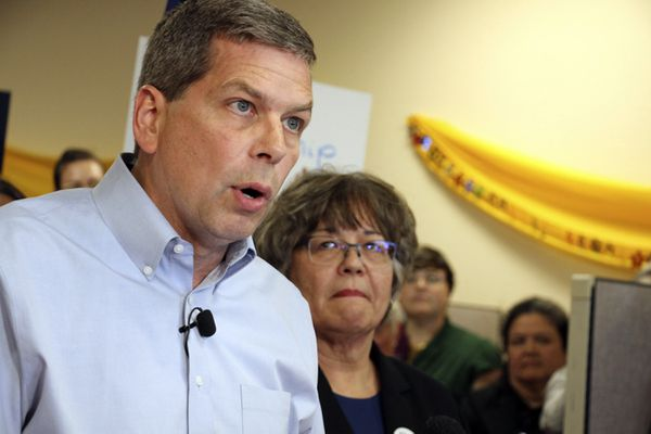 FILE - In this Sept. 4, 2018 file photo, Democrat Mark Begich, left, shown with his lieutenant governor running mate Debra Call, speaks during a press conference at his campaign office in Anchorage, Alaska. On Oct. 19, Gov. Bill Walker announced he was dropping his bid for re-election, though his name remains on the ballot. He threw his support behind Begich, leaving him as the sole opponent to Republican Mike Dunleavy. (AP Photo/Mark Thiessen, File)