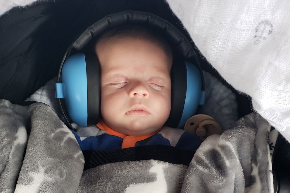Lane, the two-month-old son of two-time Olympic bronze medalist Corey Cogdell-Unrein, wears a pair of earmuffs at the USA Shooting national championships last week in Colorado Springs. (Photo courtesy of Corey Cogdell-Unrein)