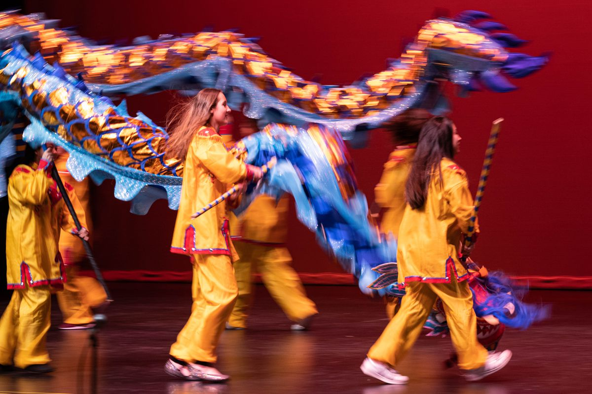 Bartlett Chinese language students perform a dragon dance Friday at Bartlett High during a Chinese New Year celebration. (Loren Holmes / ADN)