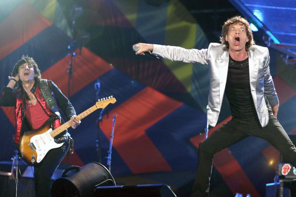 Mick Jagger, right and Ron Wood perform during a Rolling Stones concert in Rio de Janeiro, Brazil, in 2006. MUST CREDIT: Bloomberg photo by Douglas Engle