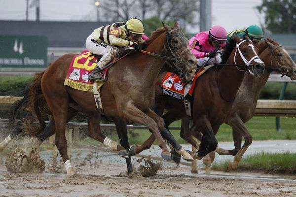 CORRECTS MAXIMUM SECURITY DISQUALIFIED, ADDS WINNER COUNTRY HOUSE - Luis Saez rides Maximum Security, center, crosses the finish line first ahead of Country House, left, and jockey Flavien Prat, during the 145th running of the Kentucky Derby horse race at Churchill Downs Saturday, May 4, 2019, in Louisville, Ky. Country House was declared the winner after Maximum Security was disqualified following a review by race stewards. (AP Photo/John Minchillo)