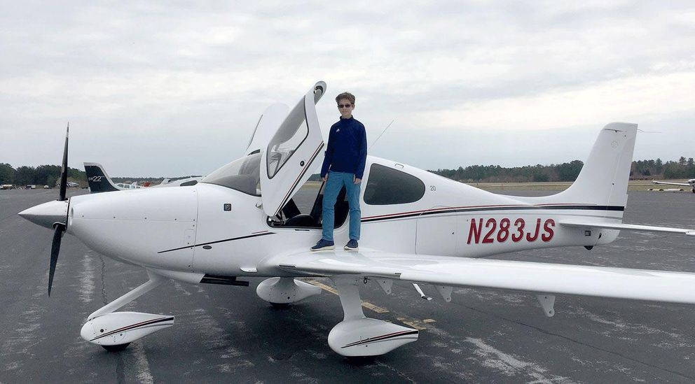 Cade Glass, 13, poses by a Cirrus SR20 airplane during a lesson at Chesterfield County Airport near Richmond, Va., in March. Glass has wanted to be a pilot since at least 7. (Scott Glass)