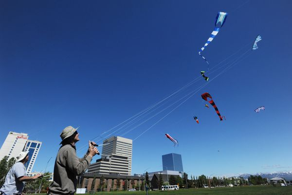 Kirk Stickley, left, and Mike Spangler with AlasKiters Kite Club fly Revolution kites during a west wind at the Delaney Park Strip on Sunday, June 3, 2018. (Bill Roth / ADN)