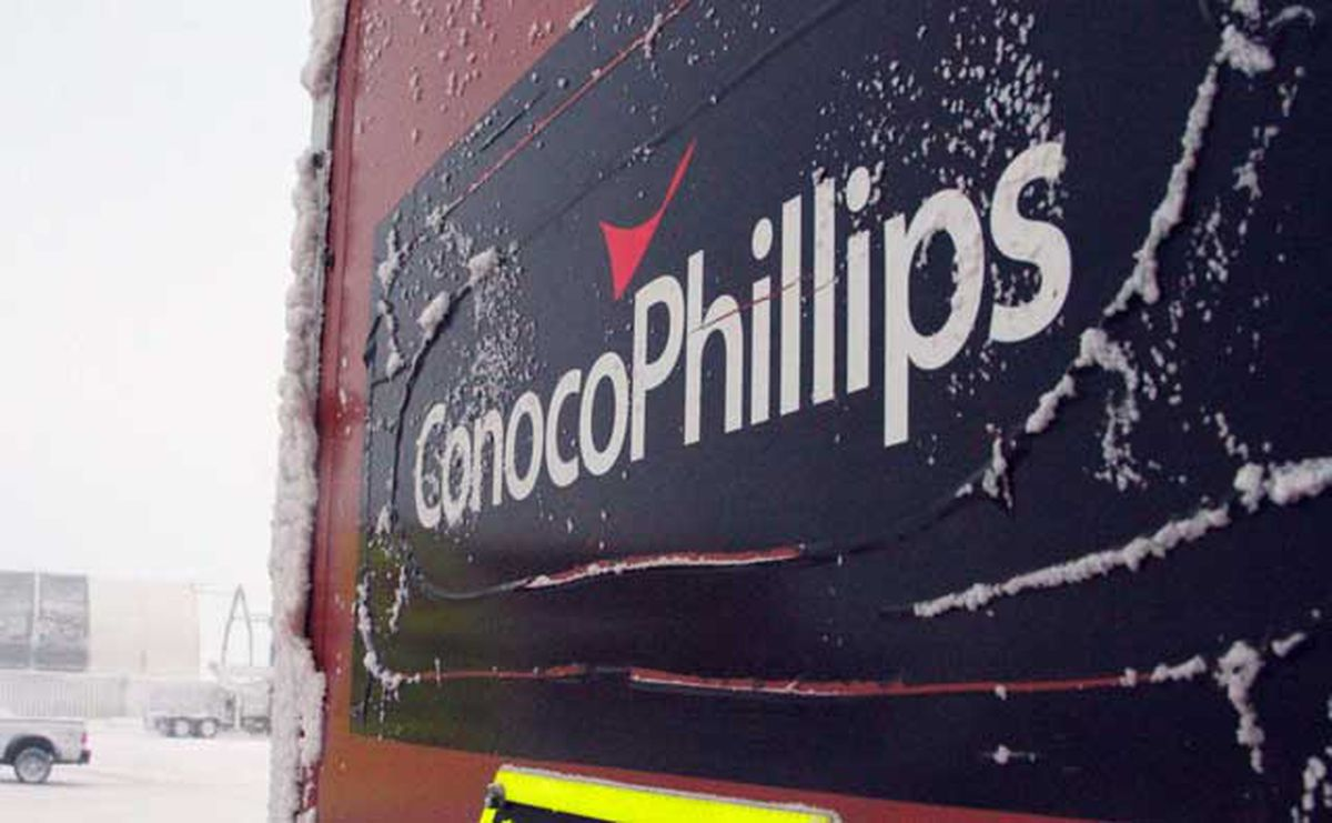 This Feb. 9, 2016, file photo shows an ice-covered ConocoPhillips sign at a drilling site on Alaska's North Slope. (AP Photo/Mark Thiessen)