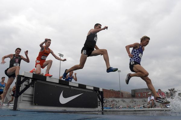 Jun 22, 2018; Des Moines, IA, USA; Craig Nowak (9), Isaac Updike (3), Aidan Tooker of Syracuse (11) and Steven Fahy of Stanford (12) race over the water jump in steeplechase heat during the USA Championships at Drake Stadium. Mandatory Credit: Kirby Lee-USA TODAY Sports
