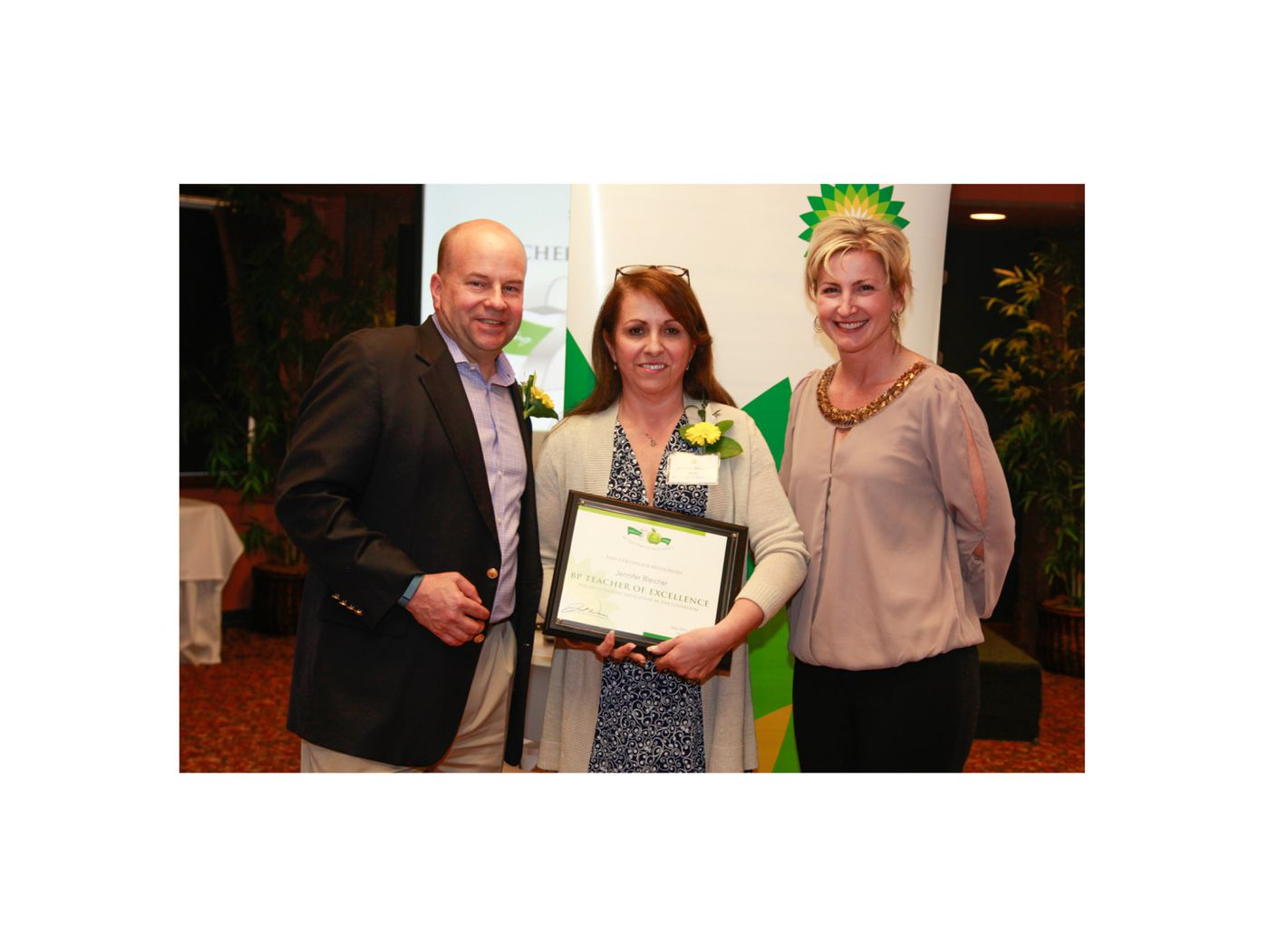 Cottonwood Creek Elementary School teacher Jennifer Bleicher (pictured in the middle) received the BP Teachers of Excellence Award in 2015. Photo courtesy of BP.