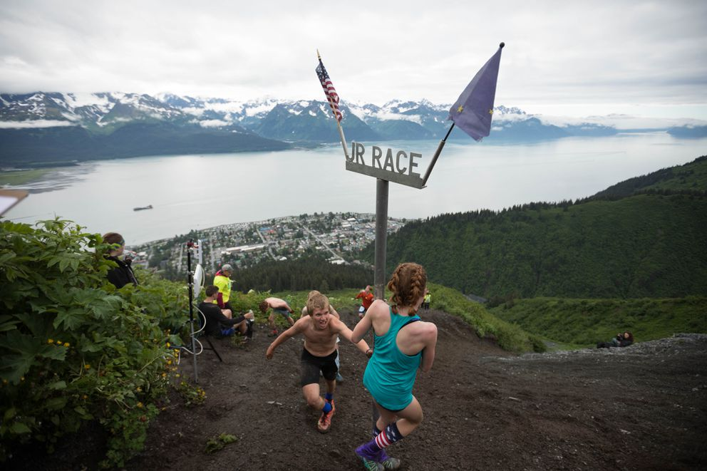 Competitors go around the halfway point of the 2017 Mount Marathon junior's race in Seward on Tuesday. (Loren Holmes / Alaska Dispatch News)