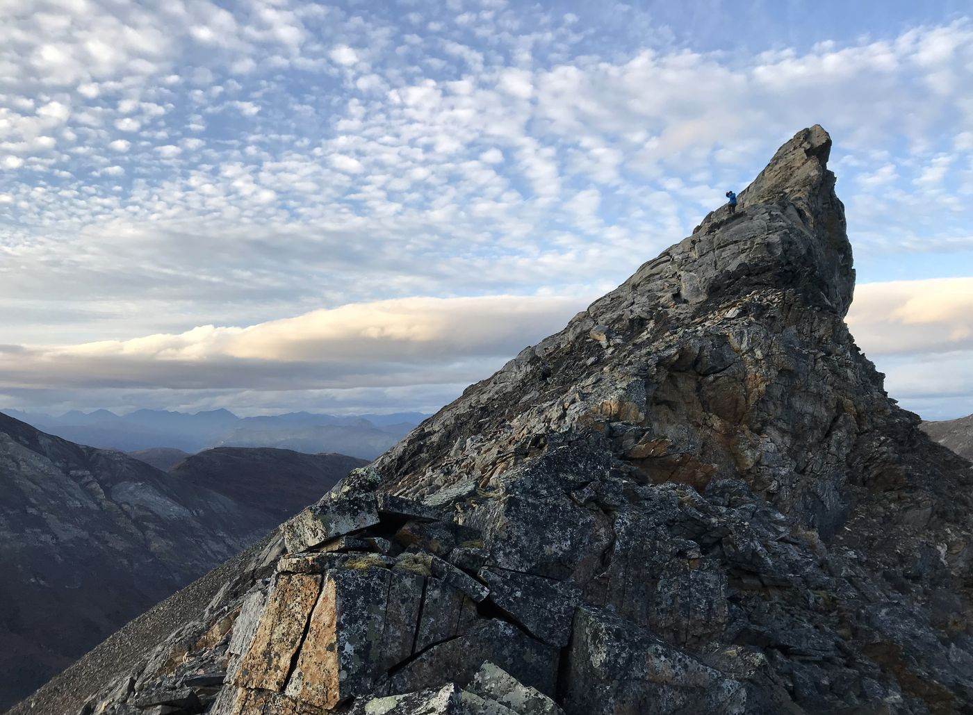 Jussi Ruottinen hikes along a ridge in the Arrigetch Peaks on Monday, Sept. 3, 2018. (Vicky Ho / ADN)