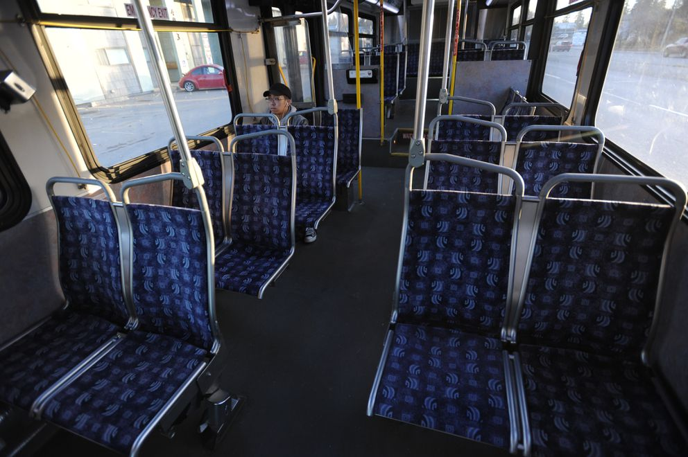 Dan Distor rides the Route 36 bus from downtown Anchorage to UAA on Tuesday. People Mover will launch a revised bus system on Monday that will eliminate the route serving West Anchorage and U-Med. (Bill Roth / Alaska Dispatch News)