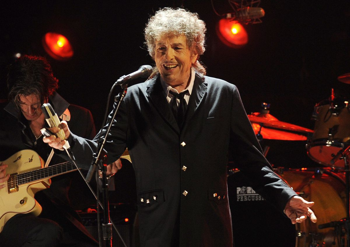 """In this Jan. 12, 2012, photo, Bob Dylan performs in Los Angeles. Universal Music Publishing Group is buying legendary singer Bob Dylan's entire catalog of songs. The company said Monday, Dec. 7, 2020, that the deal covers 600 song copyrights including """"Blowin' In The Wind,"""" """"The Times They Are a-Changin',"""" and """"Knockin' On Heaven's Door,"""" """"Tangled Up In Blue."""