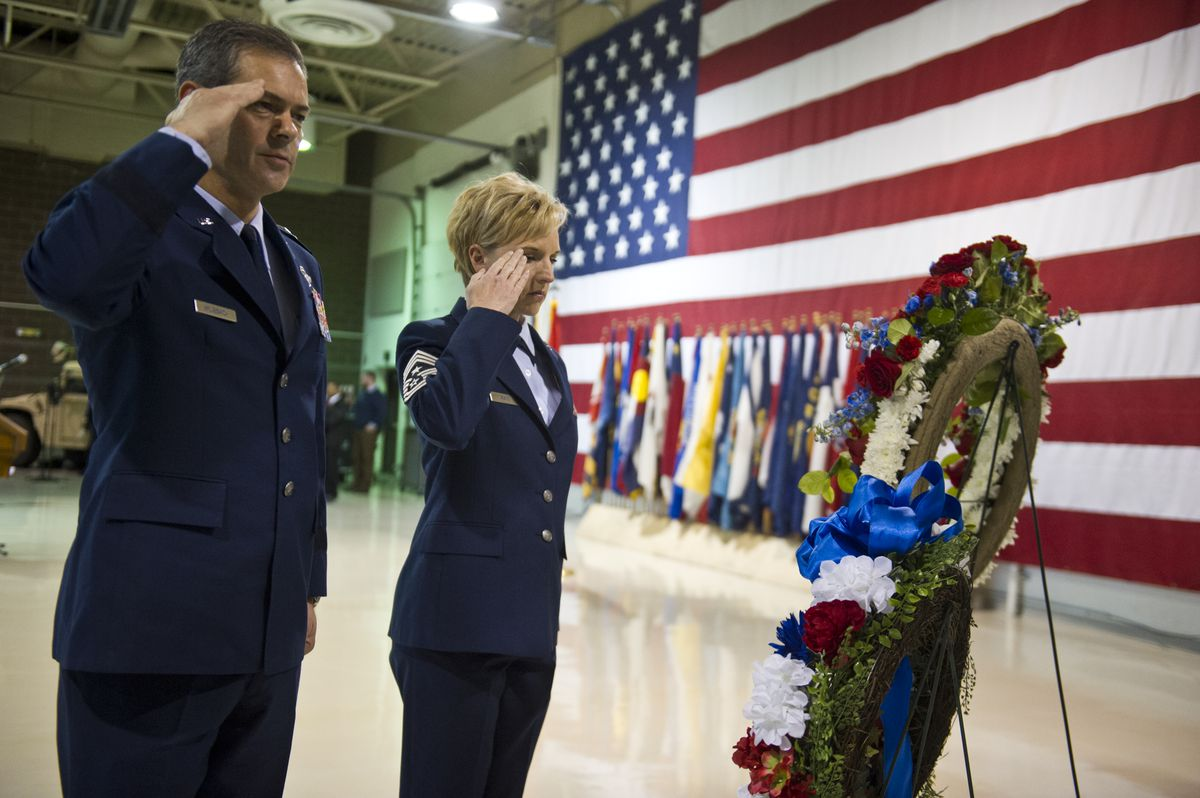 Lt. Gen. Kenneth Wilsbach and Chief Master Sgt. Gay Veale salute after placing a wreath at the Veterans Day ceremony at the Alaska National Guard on Joint Base Elmendorf-Richardson on November 11, 2016. (Marc Lester / ADN)