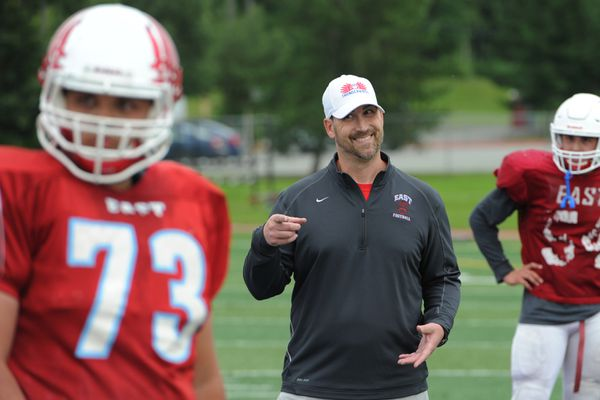 East High head coach Jeff Trotter runs his offense through plays as the defending state champion Thunderbirds prepare for the upcoming football season on Wednesday, July 26, 2017. (Bill Roth / Alaska Dispatch News)